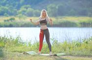 Young beautiful woman squats shows result press on stomach workout training Stock Photos
