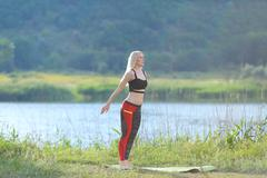 Young beautiful woman squats shows result press on stomach workout training Kuvituskuvat