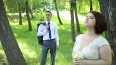 The bride and groom in the woods. Stock Footage