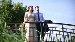 Bride and groom on the bridge. Stock Footage