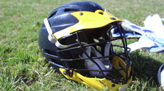 Lacrosse equipment laid out on a grass field. Arkistovideo