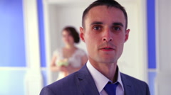 The groom on the background of the bride. Clouse up Stock Footage