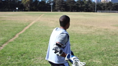 A lacrosse player stretching and warming up. Stock Footage