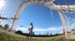 Lacrosse player practicing taking shots at a goal. Stock Footage