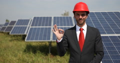Positive Business Male Looking Camera Ok Sign Hand Gesture Solar Panels Source Stock Footage
