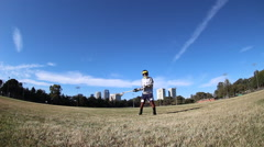 A young man playing lacrosse. Stock Footage