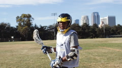 Portrait of a young man playing lacrosse. Stock Footage