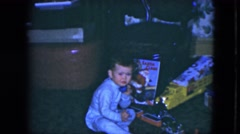 1951: a toddler having fun during the holidays with his toy phone. CLEVELAND, Stock Footage