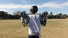 Portrait of a young man playing lacrosse. Arkistovideo
