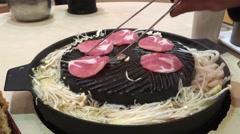 Man eating Japanese Meat Balls call Takoyaki closeup Stock Footage