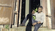 Man Answers A Phone Call And Laughs, While Hanging Out And Relaxing In Park Stock Footage
