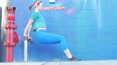 A couple working out and doing body weight exercises together in an urban envir Stock Footage