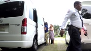 Wealthy family alighting from luxury van Stock Footage