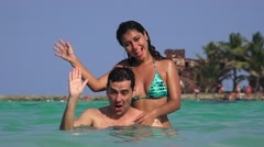 Happy Couple Waving And Swimming In Ocean Stock Footage