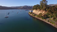 Aerial view over Akaroa lighthouse and harbour, New Zealand Stock Footage