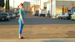 A young woman doing sprints in the streets of an urban environment. Stock Footage