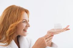 Happy senior lady enjoying skin treatment Kuvituskuvat