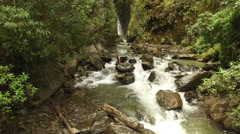 Travel and Adventure - Man in waterfall Ecuador Stock Footage