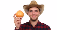 Optimistic Gardener Farmer Man Look Camera and Holding Organic Garden Grapefruit Stock Footage
