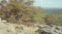 An older man admiring the view while on a scenic hike in the mountains. Stock Footage