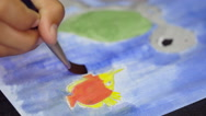 The child draws water color paints on a paper Stock Footage
