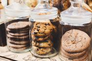Cookies and biscuits in glass jars on bar for sale Stock Photos