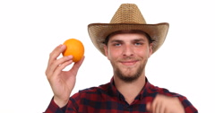 Happy Farm Worker Man Holding Sweet Juicy Orange and Show Ok Sign Hand Gesture Stock Footage