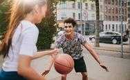 Young friends having a game of basketball Stock Photos