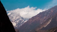 Clouds at the Himalayan mountain range as seen from Beni. Timelapse Stock Footage