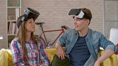 Young Woman and Man with VR Goggles Chatting Stock Footage