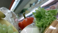 Trolley full of goods goes to a supermarket Stock Footage