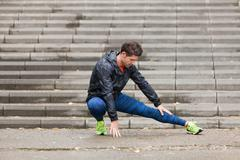 Athletic young man preparing for his morning running routine. Stock Photos