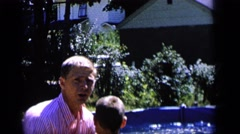 1964: kid being thrown in pool by dad CAMDEN NEW JERSEY Stock Footage