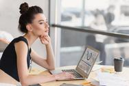 Stylish girl dreaming on her workplace Stock Photos