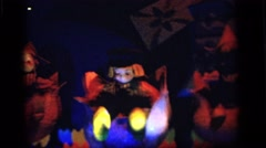 1964: automated puppets displaying unique cultures from around the globe CAMDEN Stock Footage