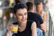 Pretty lady holding glass of lemonade Stock Photos