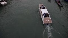 Motor boats and Gondolas sail at the Rialto bridge Stock Footage