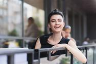 Happy beautiful female student in a cafe Stock Photos
