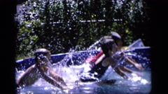 1964: enjoying group bath in childhood days is always amazing and full of fun Stock Footage
