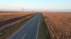 Motorcyclist Goes the Way of the Field. HD Video Stock Footage