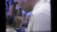 1964: dozens of people including children mengling around a pond  Stock Footage
