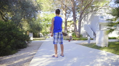 Person with longboard under hand posing on concrete path 4K Stock Footage