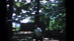 1964: playing badminton with friends. CAMDEN NEW JERSEY Stock Footage