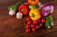 Fresh vegetables on brown wood background Stock Photos