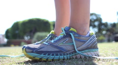 A woman runner tying shoes before her run. Stock Footage