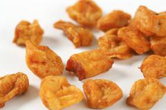 Fried pieces of pork rind and fat Stock Photos