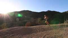 A young woman runner trail running. Stock Footage