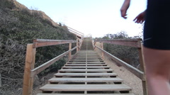 A young woman runner running stairs. Stock Footage