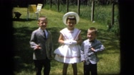 1964: children dressed up for church posing CAMDEN NEW JERSEY Stock Footage