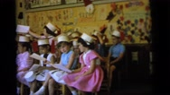 1964: children are seen indoors playing CAMDEN NEW JERSEY Stock Footage